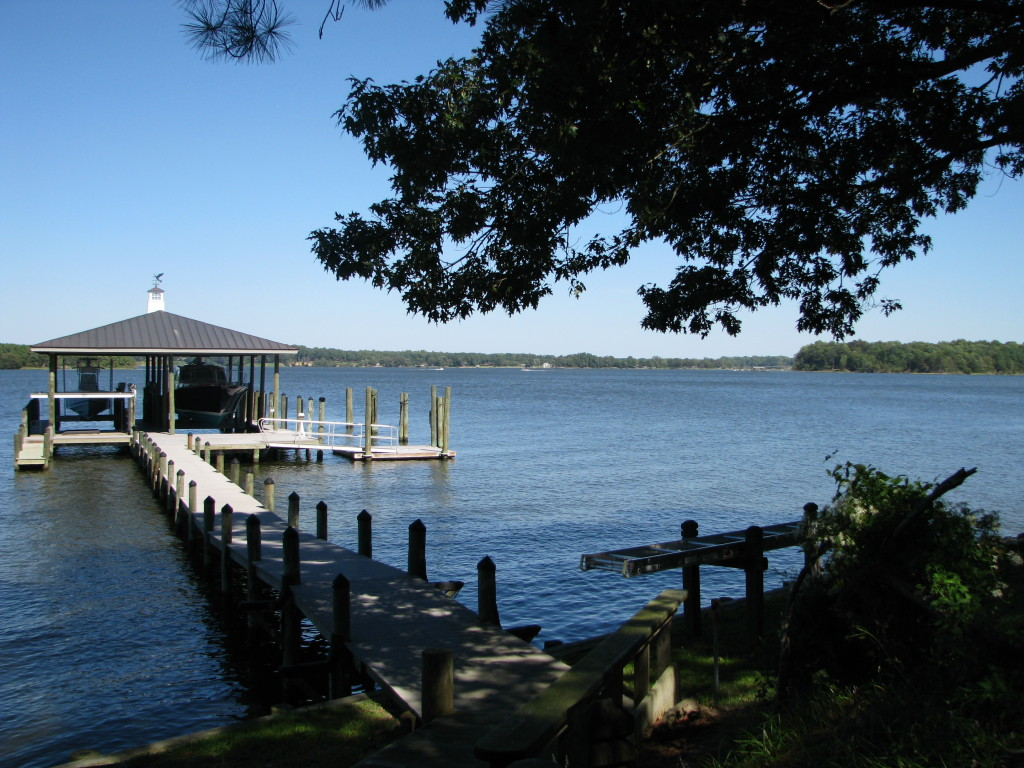 Low maintenance Pier with covered boat and yacht slips, floating dock and open very large yacht slip.