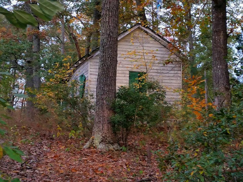 abandoned cabin at charlton hill overlooking water